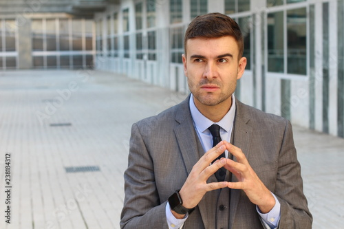 Cuadros en Lienzo Evil businessman planning a revenge
