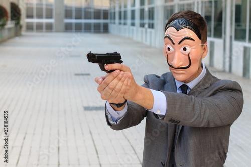 Businessman with mask holding a gun Wallpaper Mural