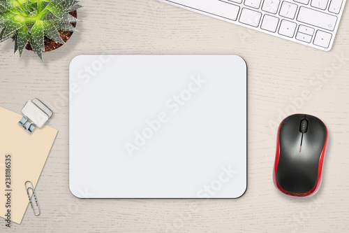 Obraz Mouse pad mockup. White mat on the table with props, mouse and keyboard - fototapety do salonu