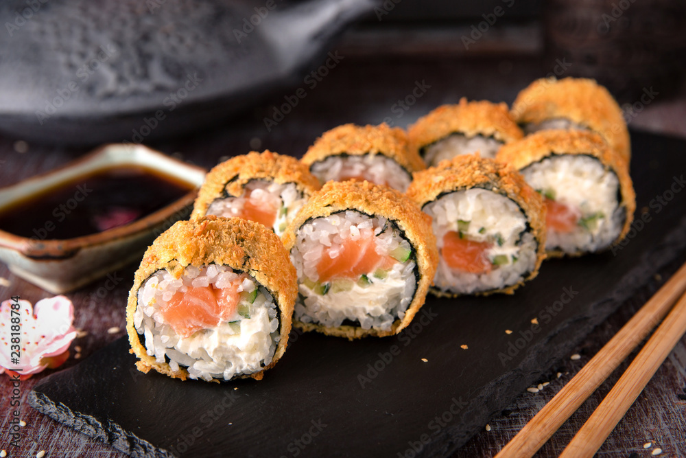 Fototapety, obrazy: Hot fried Sushi Roll with salmon, avocado and cheese. Sushi menu. Japanese food.