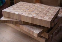 Left-over Pieces Of Plywood Stacked In Carpenter's Workshop