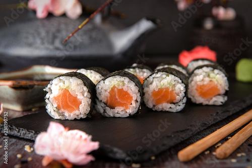 Fototapeta Maki rolls with salmon and cheese. Sushi menu. Japanese food.  obraz