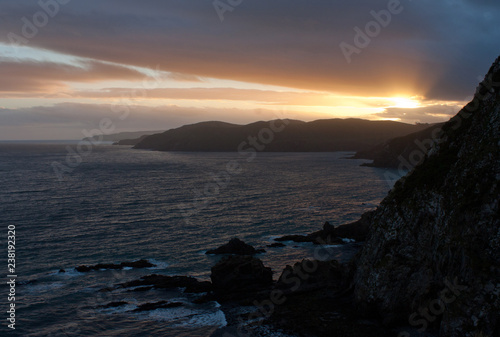 Photo  Sunset at the Nugget Point in the Catlins in the Central Otago in the South Isla