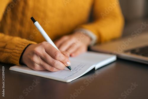 Obraz Writing in notebook. Close-up. - fototapety do salonu