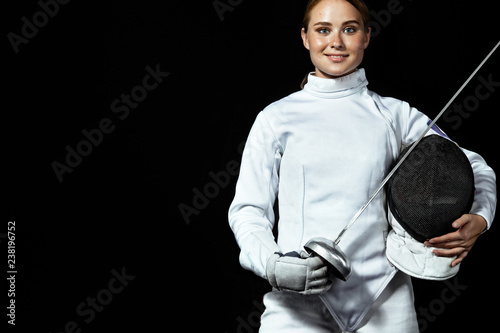 Young fencer athlete wearing fencing costume holding the sword and mask Wallpaper Mural