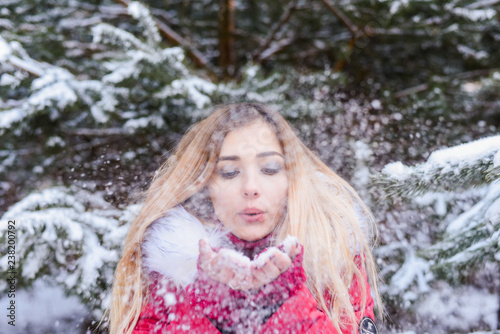 Recess Fitting Fantasy Landscape Outdoor waist up portrait. Young beautiful happy smiling girl walking on pine forest . Model with blue eyes,wearing stylish sweater. Magic snowfall. Space for text