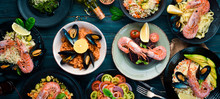 A Set Of Seafood Dishes On A Blue Wooden Background. Pasta, Bulgur, Rice, Couscous. Top View. Free Space For Your Text.