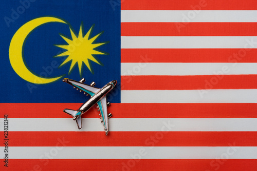 Fotografía  Plane over the flag of Malaysia, the concept of journey.
