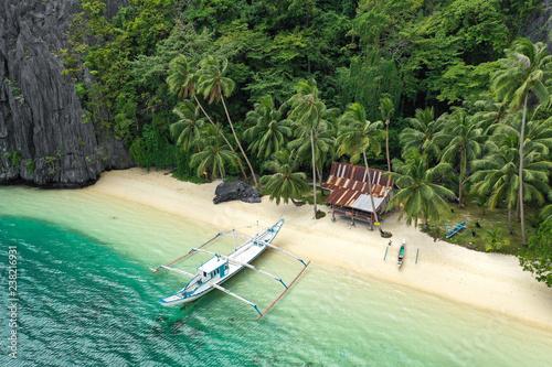 Aerial drone view of turquoise coastal waters and limestone cliffs in El Nido archipelago tourist destination Fototapeta
