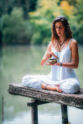 Foto op Canvas Ontspanning Young woman with Tibetan Singing Bowl