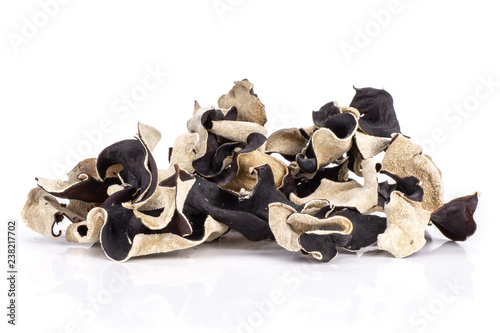 Lot of slices of dry black mushroom jew ear variety stack isolated on white back Canvas Print