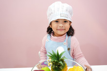 Asian Kid Chef With Healthy Fruit.