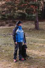 Man With His Black Labrador Do...