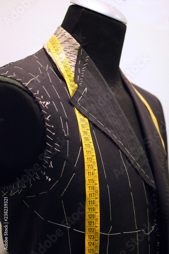 Mannequin with basted  jacket by a tailor Wallpaper Mural