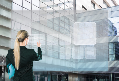 Keuken foto achterwand Akt Businesswoman pressing virtual touchscreen