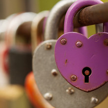 Padlocks Hang On The Fence Of The Bridge As A Symbol Of Love, Loyalty And Joint Happiness