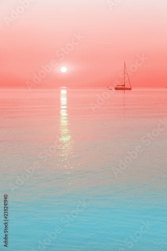 Fotografía  sun and a sailing boat in living coral color sunrise with blue waters, color of the year 2019