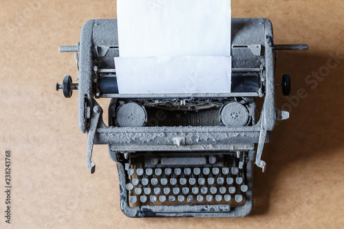 Fotobehang Retro old vintage dust-covered typewriter with sheet of white paper