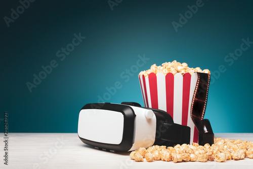 Fotografie, Obraz  Composition of VR goggles and popcorn