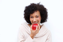 Close Up Healthy African American Woman Eating Apple
