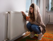 Girl in jacket beside radiator at home