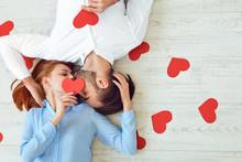 Couple Kisses Lying On A Floor...