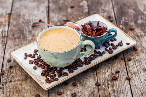 Fotografie, Obraz  Oatmeal porridge with coffe and grated chocolate on bright wooden table