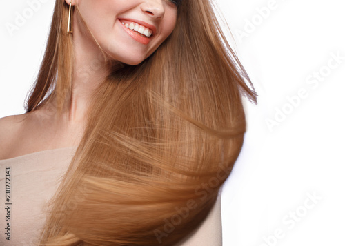 Photo  Beautiful blond girl with a perfectly smooth hair, classic make-up