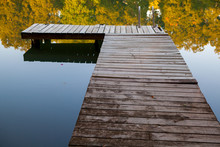 Old Wooden Dock On Lake With ...