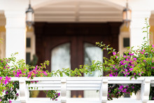 Closeup Of Mansion Entrance Balcony Terrace Railing With Pink And Purple Flowers Decorations In Florida Luxury Real Estate Property Exterior