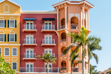 Florida Condo, Condominium Colorful, Red And Orange Multicolored Buildings Facade Exterior With Windows, Palm Trees, Real Estate Property In Spain