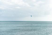 Man Surfing, Kitesurfing With ...