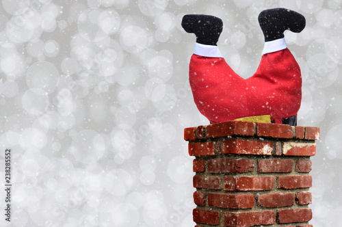 Fotografiet Santa Claus upsidedown in a chimney