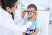 Children's Doctor Putting Glas...