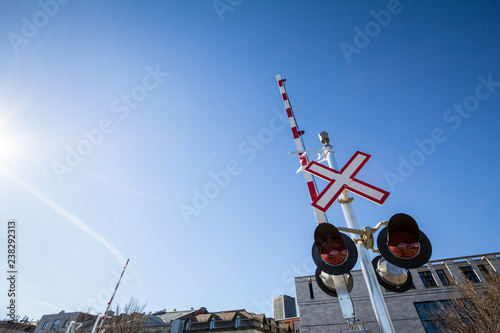 Valokuvatapetti North American level crossing with its typical road sign, saltire shaped, and re