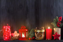 Christmas And New Year Background With Candle, Light, Decorations And Gift Box On Wooden Shelf. Copy Space