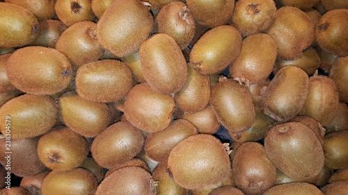 Fotografie, Obraz Fresh kiwi fruit used for wallpaper background