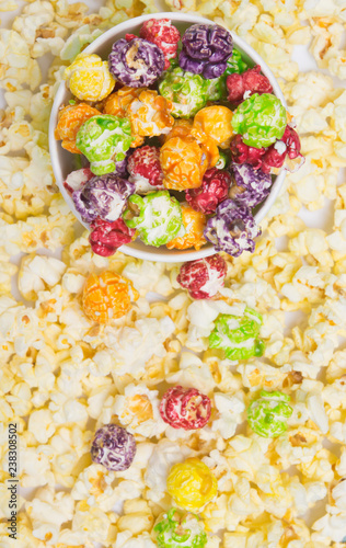 Keuken foto achterwand Buffet, Bar bucket of colorful, fruit popcorn, on the background of scattered flakes