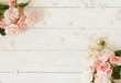 Leinwanddruck Bild - Flowers background. Bouquet of beautiful pink roses on white wooden background.Top view.Copy space