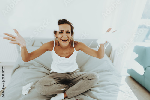 Sad Woman With Flowed Mascara Crying On The Bed. Canvas Print