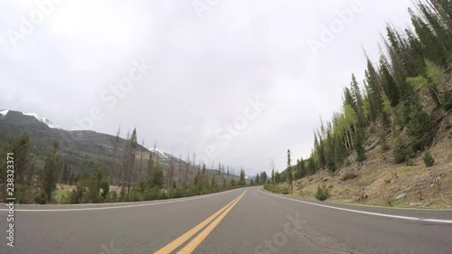 Wall mural - Driving on paved road in Rocky Mountain National Park.