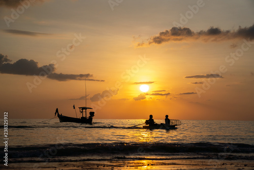Türaufkleber Schiff Beach sunset and fisherman boat for commercial background