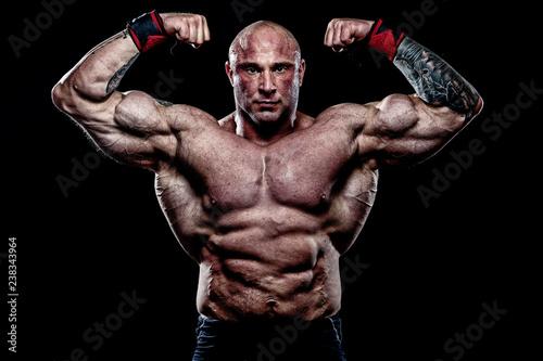 Fotografie, Obraz  Muscular Man on Black Background