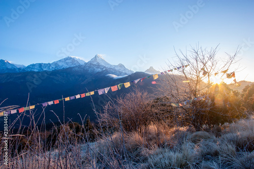 Mount Annapurna at dawn on Poon Hill in Nepal among prayful tags