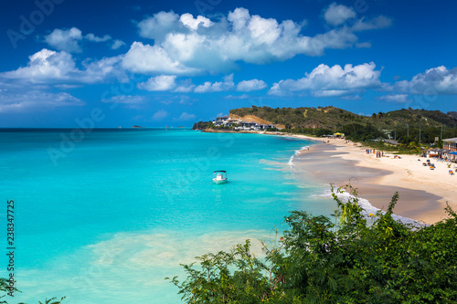 Tropical beach at Antigua island in Caribbean with white sand, turquoise ocean w Canvas Print