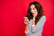 Leinwanddruck Bild - Portrait of nice adorable funny attractive amazed wondered stunned wavy-haired lady wearing striped pullover reading sms notification oops great isolated over bright vivid shine red background