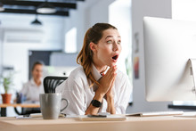 Shocked Young Businesswoman Si...