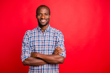 Portrait Of Nice Handsome Well-groomed Attractive Cheerful Positive Cheery Guy Wearing Checked Shirt Isolated Over Bright Vivid Shine Red Background