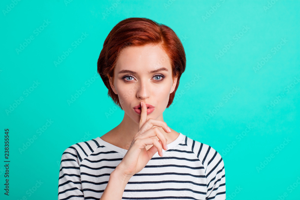 Fototapeta Close-up portrait of nice attractive sweet lovely red-haired lady in striped pullover showing hush sign symbol isolated over bright vivid shine green turquoise background