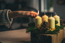 Lighting A Candle On Advent Wreath